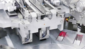 Automatic filling and wrapping machines for pasty foodstuffs